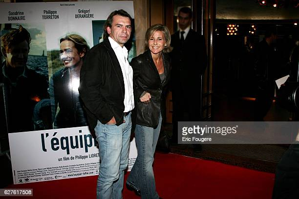 Costar Philippe Torreton and partner Claire Chazal arrive at the premiere of 'L'equipier' in Paris