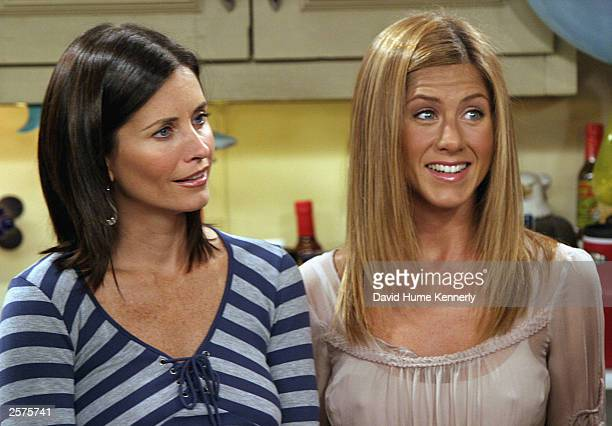 Costars Courteney Cox Arquette and Jennifer Aniston of the hit NBC series 'Friends' perform during one of their last shows on the Warner Bros lot...