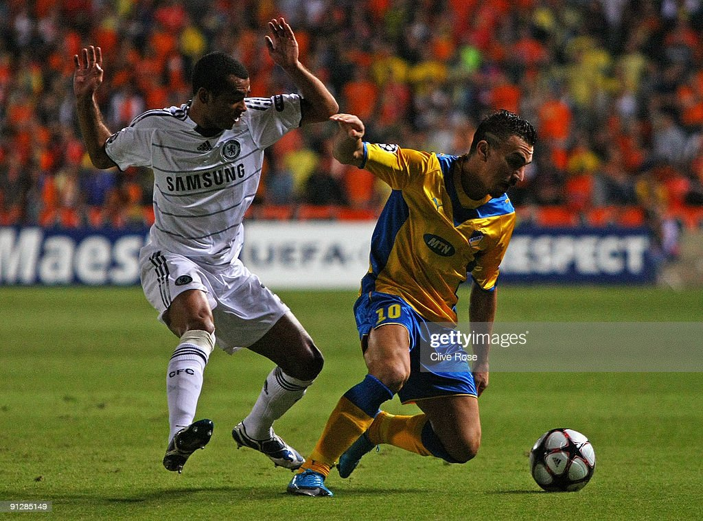 Costas Charalambides of APOEL battles with Ashley Cole of Chelsea during the UEFA Champions League Group D match between Apoel Nicosia and Chelsea at...