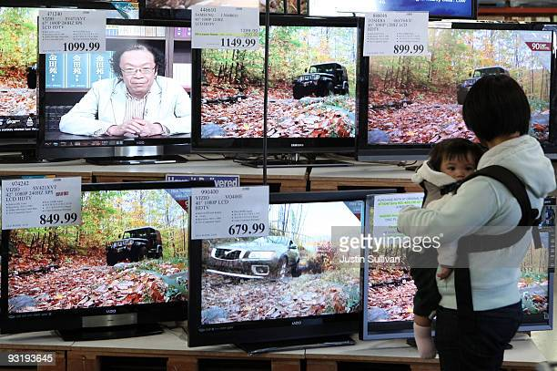 Costco customer looks at a display of LCD HDTV televisions November 18 2009 in San Francisco California The California Energy Commission voted...