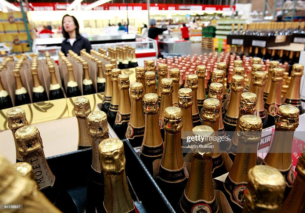 Costco customer shops for champagne at a Costco store December 29 2008 in South San Francisco California As the economy continues to falter sales of...