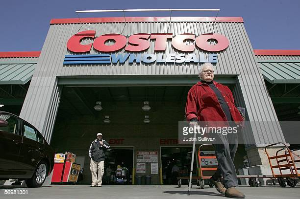 Costco customers walk in front of a Costco Warehouse store March 2006 in Richmond California Costco Wholesale Corporation the nation's largest...