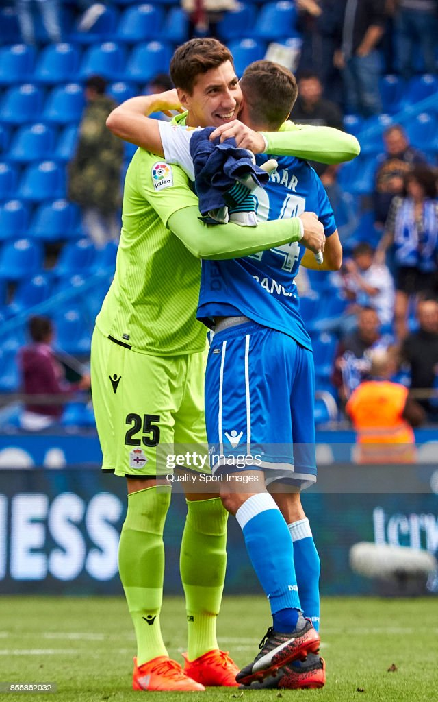 Costel Pantilimon of Deportivo de La Coruna celebrate the victory with Fabian Schar of Deportivo de La Coruna during the La Liga match between Deportivo La Coruna and Getafe at Abanca Riazor Stadium on September 30, 2017 in La Coruna, Spain.