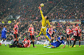 Costel Pantilimon of Sunderland stretches for the ball as he is challenged by John Terry of Chelsea during the Barclays Premier League match between...