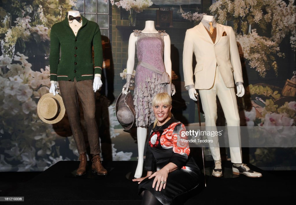 Costume Designer Catherine Martin poses with her sample collection at the debut celebration of Fashion In Film at Tribeca Cinemas on September 19...