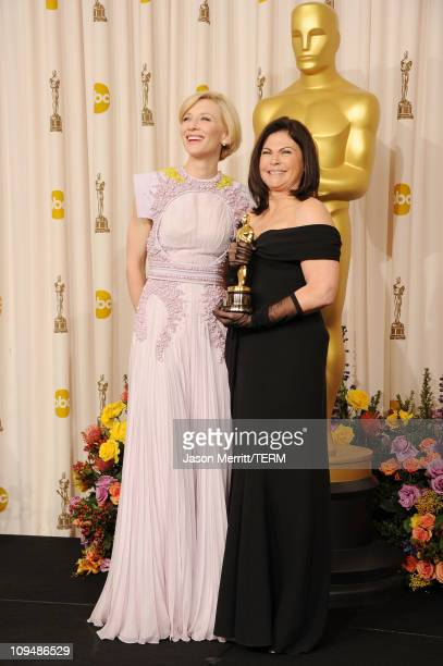 Costume designer Colleen Atwood winner of the award for Best Costume Design for 'Alice in Wonderland' and presenter Cate Blanchett pose in the press...
