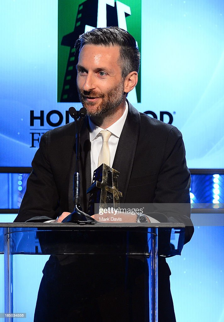 Costume designer Michael Wilkinson accepts the Hollywood Costume/Production Designer Award for 'American Hustle' onstage during the 17th annual Hollywood Film Awards at The Beverly Hilton Hotel on October 21, 2013 in Beverly Hills, California.