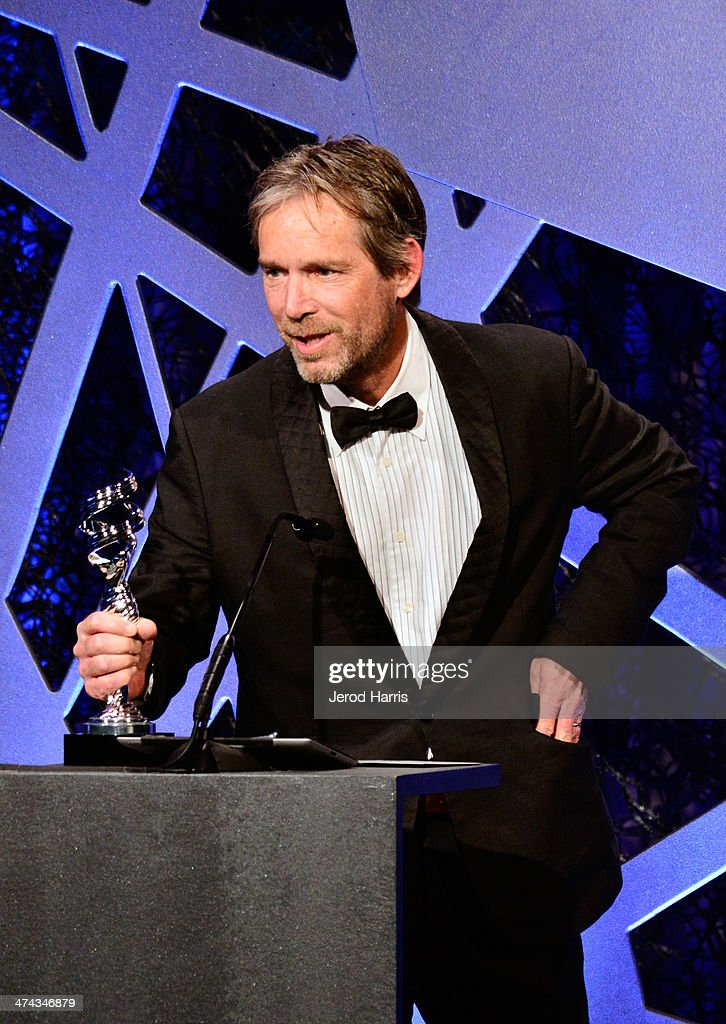 Costume designer Michael Wilkinson speaks onstage during the 16th Costume Designers Guild Awards with presenting sponsor Lacoste at The Beverly Hilton Hotel on February 22, 2014 in Beverly Hills, California.