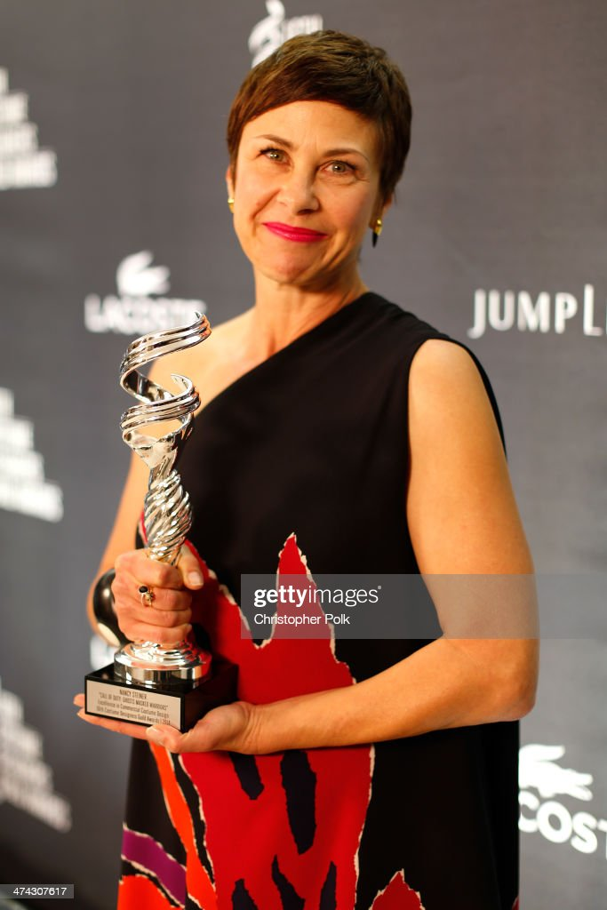 Costume designer Nancy Steiner poses with the award for Excellence in Commercial Costume Design for Call of Duty: 'Ghosts Masked Warriors' during the 16th Costume Designers Guild Awards with presenting sponsor Lacoste at The Beverly Hilton Hotel on February 22, 2014 in Beverly Hills, California.