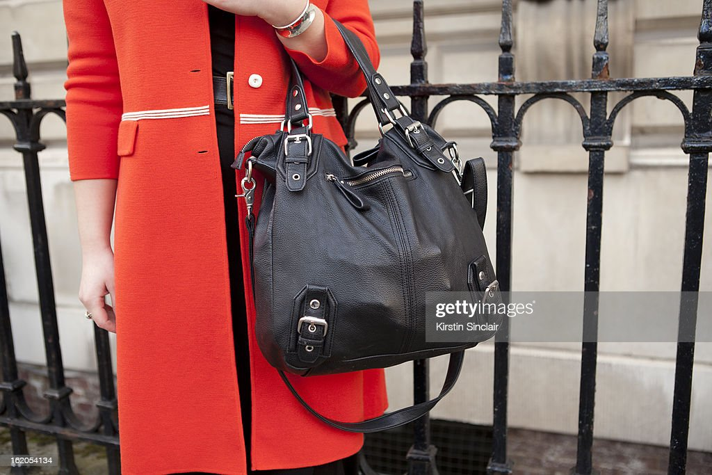 Costume Designer Olivia Hulme wears a Urban Outfitters purse and vintage jacket, , on day 3 of London Womens Fashion Week Autumn/Winter 2013 on February 17, 2013 in London, England.