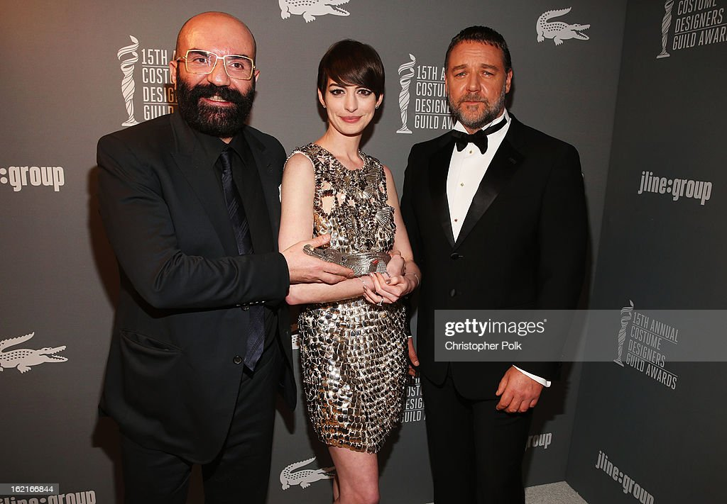 Costume Designer Paco Delgado (L) and actors <a gi-track='captionPersonalityLinkClicked' href=/galleries/search?phrase=Anne+Hathaway+-+Actress&family=editorial&specificpeople=11647173 ng-click='$event.stopPropagation()'>Anne Hathaway</a> and <a gi-track='captionPersonalityLinkClicked' href=/galleries/search?phrase=Russell+Crowe&family=editorial&specificpeople=202609 ng-click='$event.stopPropagation()'>Russell Crowe</a> attend the 15th Annual Costume Designers Guild Awards with presenting sponsor Lacoste at The Beverly Hilton Hotel on February 19, 2013 in Beverly Hills, California.