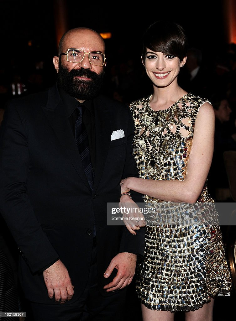 Costume Designer Paco Delgado and Actress <a gi-track='captionPersonalityLinkClicked' href=/galleries/search?phrase=Anne+Hathaway+-+Actress&family=editorial&specificpeople=11647173 ng-click='$event.stopPropagation()'>Anne Hathaway</a> attend the 15th Annual Costume Designers Guild Awards with presenting sponsor Lacoste at The Beverly Hilton Hotel on February 19, 2013 in Beverly Hills, California.