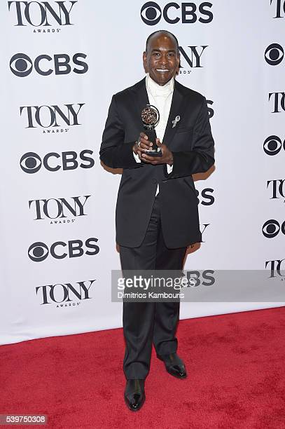Costume designer Paul Tazewell poses with award for Best Costume Design in a Musical during the 70th Annual Tony Awards at The Beacon Theatre on June...