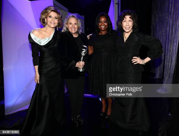 Costume designer Renee Ehrlich Kalfus winner of the Excellence in Period Film award for 'Hidden Figures' poses with actors Jane Fonda Octavia Spencer...