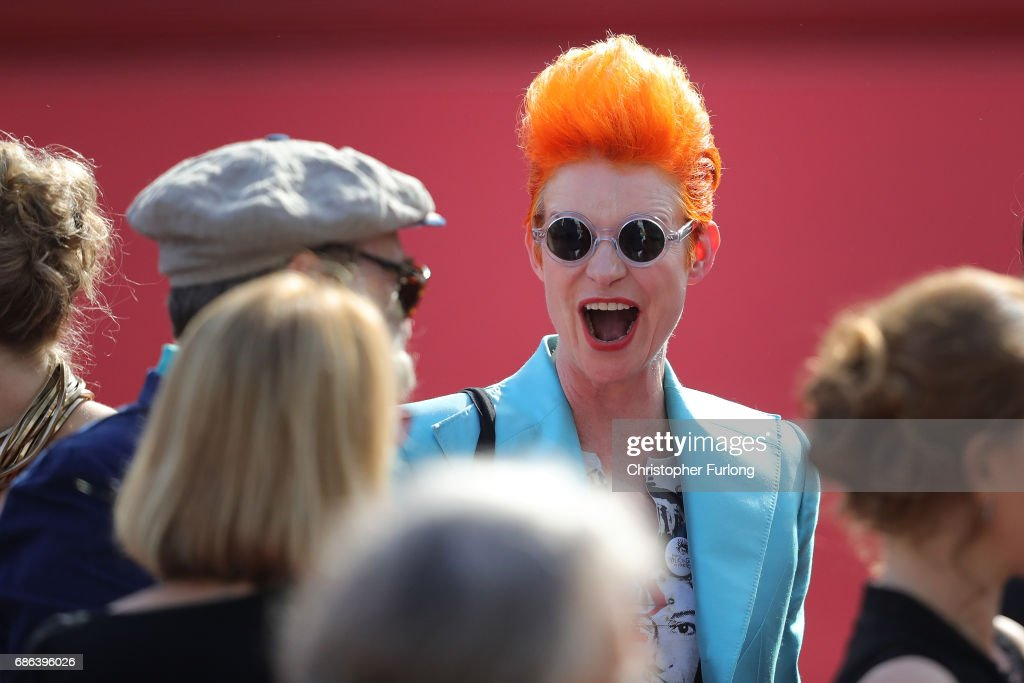 Costume designer Sandy Powell departs the 'How To Talk To Girls At Parties' premiere during the 70th annual Cannes Film Festival at Palais des Festivals on May 21, 2017 in Cannes, France. Celebrities, fans and the movie world have descended on Cannes for this year's festival of the screen. For seventy years The Croisette Boulevard has always been the centre of athe place watch the rich and dandy and people from all walks of life to promenade.