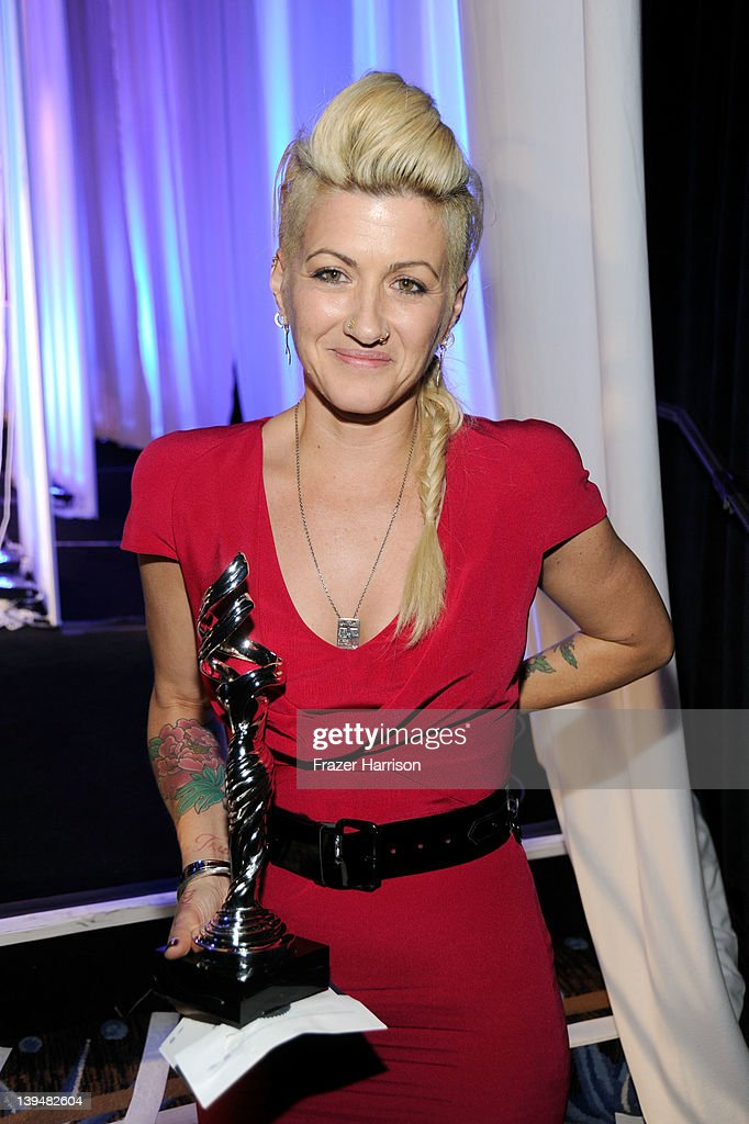 Costume designer Trish Summerville poses with the Excellence in Contemporary Film award during the 14th Annual Costume Designers Guild Awards With Presenting Sponsor Lacoste held at The Beverly Hilton hotel on February 21, 2012 in Beverly Hills, California.