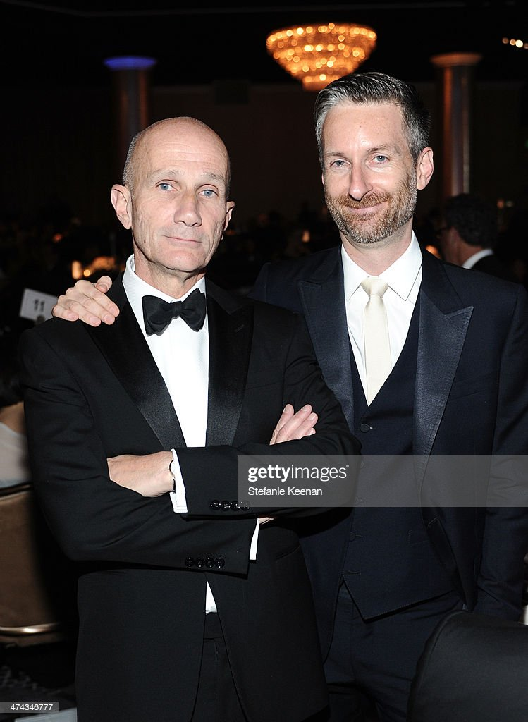 Costume designers Daniel Orlandi (L) and Michael Wilkinson attend the 16th Costume Designers Guild Awards with presenting sponsor Lacoste at The Beverly Hilton Hotel on February 22, 2014 in Beverly Hills, California.