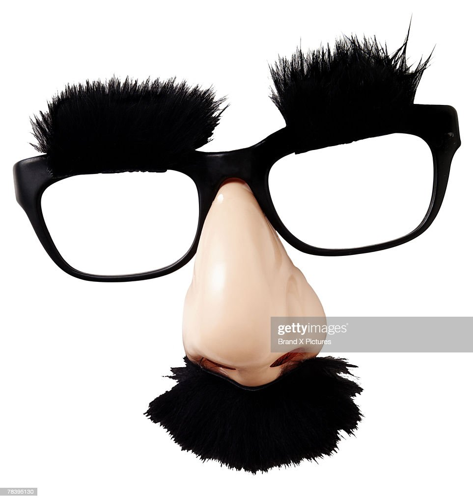 Costume glasses with hairy eyebrows and mustache : Stock Photo