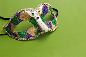 Costume mask on green background