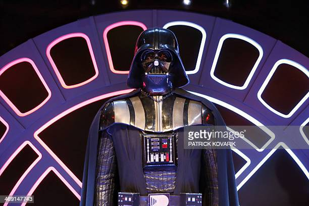 A costume of character Darth Vader from the Star Wars film series is displayed during the presentation of the exhibition 'Star Wars Identities' at...