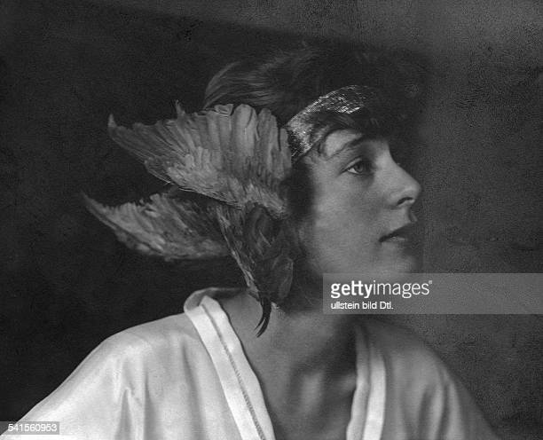 Costume party in BadenBaden Ms Thea Brueckmann with fancy feather headdress 1921Vintage property of ullstein bild