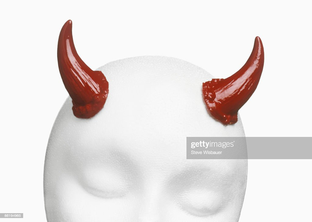 Costume red devil horns for use as design element
