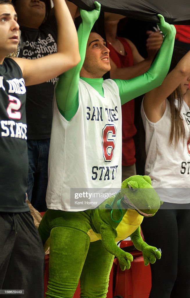 A costume wearing student section fan and member of The Show supports the San Diego State Aztecs as they are introduced prior to the first half of the game against the University of San Diego Tereros at Viejas Arena on December 15, 2012 in San Diego, California.
