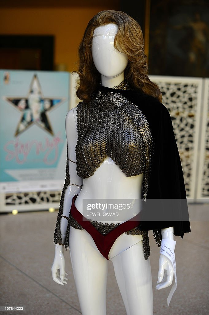 A costume worn by actress Jane Fonda in the 1968 film Barbarella is displayed during an exhibition at the Italian embassy in Washington, DC, on May 1, 2013. The exhibition, titled 'Star Wigs La Mano Italian Crea' is organized to give tribute to Italian cultural and historical heritage of creating a character in the film industry, showcased wigs and costumes used in historical films and actors such as Sofia Coppola's Marie Antoniette, Fellini's Casanova, Visconti's Angelica, Jane Fonda's Barbarella, Nicole Kidman's Moulin Rouge and Elizabeth Taylor's Cleopatra. AFP PHOTO/Jewel Samad