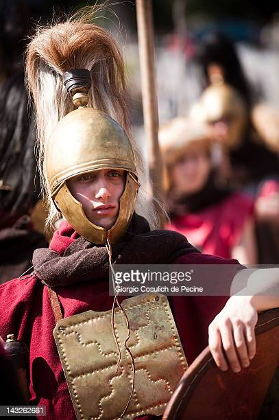 Costumed actors dressed as ancient Roman soldiers march in a commemorative parade during the festivities for the founding of Rome on April 22 2012 in...