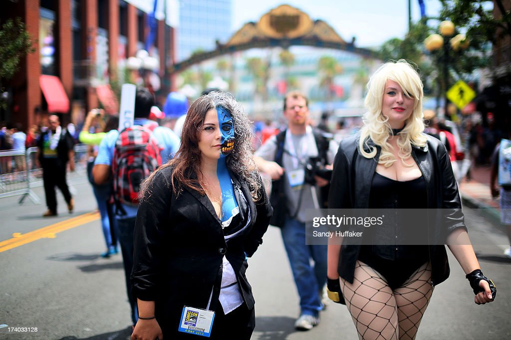 Costumed attendees walk down Fifth Avenue during Comic Con on July 19, 2013 in San Diego, California. The Comic Con International Convention is the world's largest comic and entertainment event and hosts celebrity movie panels, a trade floor with comic book, science fiction and action film-related booths, as well as artist workshops and movie premieres.
