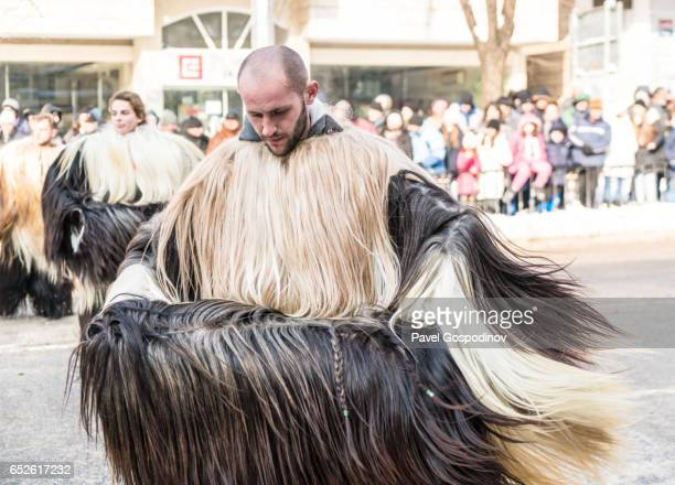 Costumed Bulgarian Man (Kuker) Participating In A Traditional Kukeri Festival