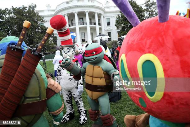 Costumed characters including the Teenage Mutant Ninja Turtles the Cat in the Hat and the Very Hungry Caterpillar participate in the 139th Easter Egg...