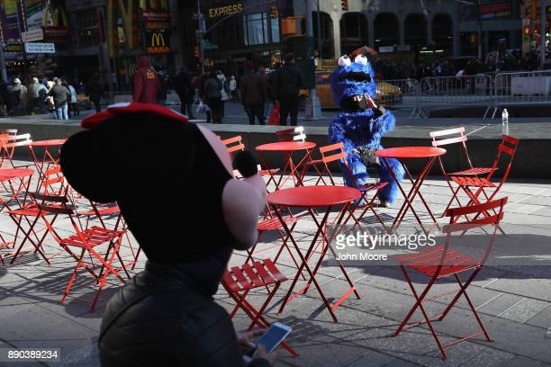 Costumed characters take a break in Times Square not far from the site of a pipe bomb explosion on December 11 2017 in New York City Police said that...