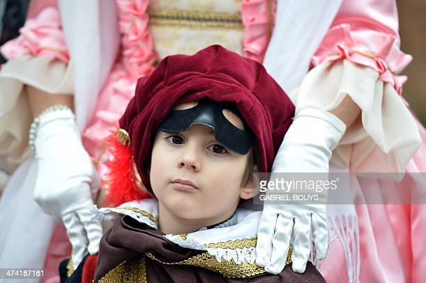 A costumed child poses during the carnival on February 22 2014 in Venice The 2014 edition of the Venice carnival is untitled ' Wonder and fantasy...