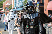 A costumed fan walks down 5th Avenue on his way to ComicCon International Day 3 on July 22 2016 in San Diego California