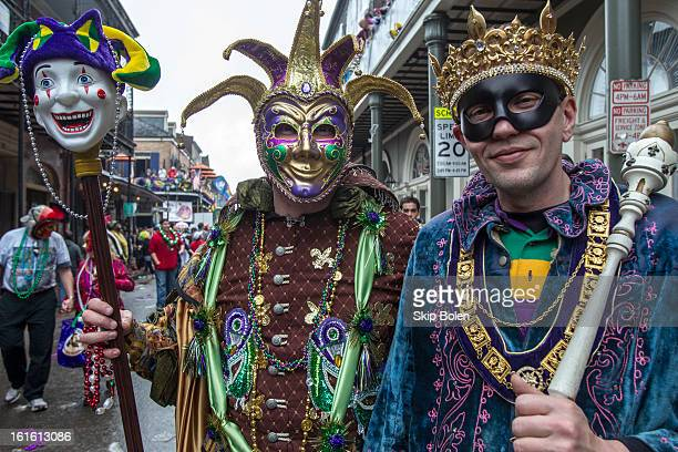 Costumed fans and revelers on Bourbon Street in the historic French Quarter on Mardi Gras Day on February 12 2013 in New Orleans Louisiana