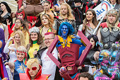Costumed fans dressed as characters from the Marvel Universe attend a group photo session at ComicCon International Day 3 on July 22 2016 in San...