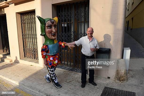 A costumed figure 'Cabezudo' pictured during the 'La Bajada de Jesús' festival in Almazán north of Spain