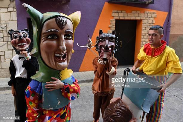 Costumed figures 'Cabezudos' pictured during the 'La Bajada de Jesús' festival in Almazán north of Spain