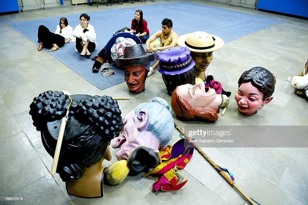 Costumed figures Gigantes and Cabezudos rest during the festivities of San Isidro at Villa Palace on May 10, 2013 in Madrid, Spain. These festivities are in honor of San Isidro Labrador and are characterized by the pilgrimages, festivals, attractions and various traditional performances.