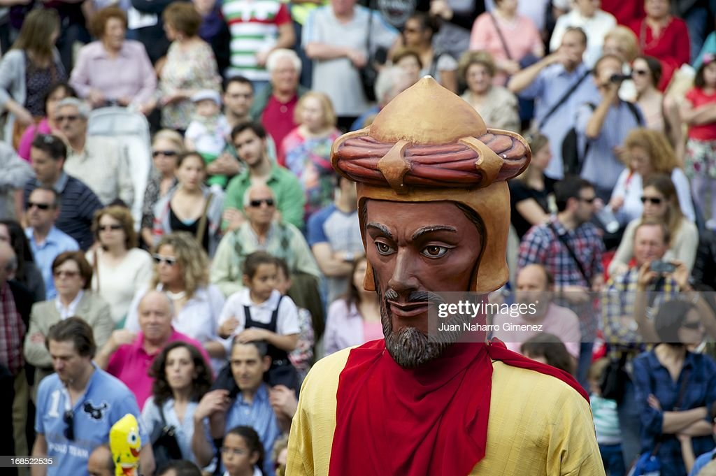 Costumed figures Gigantes and Cabezudos walk the streets of Madrid to begin the festivities of San Isidro on May 10, 2013 in Madrid, Spain. These festivities are in honor of San Isidro Labrador and are characterized by the pilgrimages, festivals, attractions and various traditional performances.