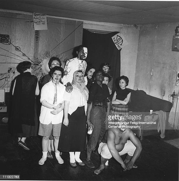 Costumed group portrait with American painter beat poet and musician Ted Joans where most of the subjects feature elaborate face painting at an...