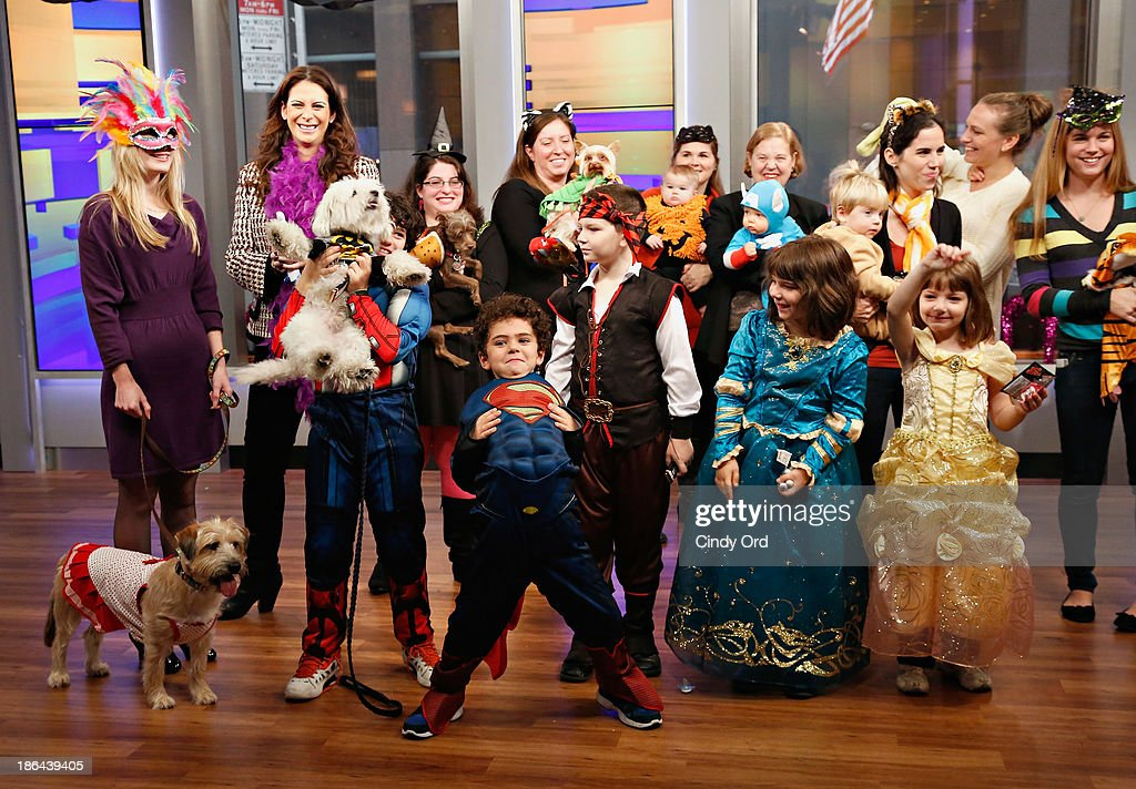 Costumed guests attend as 'FOX & Friends' celebrates Halloween at FOX Studios on October 31, 2013 in New York City.