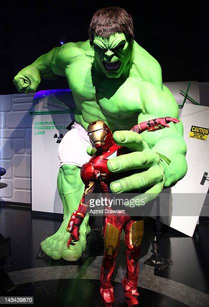 A costumed Iron Man poses with a wax figure of The Hulk at the Madame Tussauds New York's Interactive Marvel Super Hero Experience at Madame Tussauds...