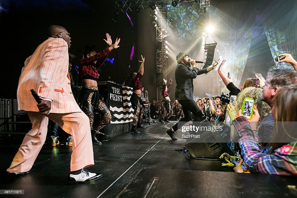 A costumed <a gi-track='captionPersonalityLinkClicked' href=/galleries/search?phrase=Macklemore&family=editorial&specificpeople=7639427 ng-click='$event.stopPropagation()'>Macklemore</a> performs at the opening night of 'Spectacle: The Music Video' exhibition at EMP Museum on May 16, 2014 in Seattle, Washington.