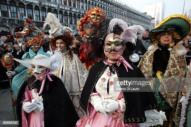 VENICE ITALY FEBRUARY 18 Costumed Partecipants of the great historical parade stand in StMark's Square during the Carnival on February 18 2006 in...