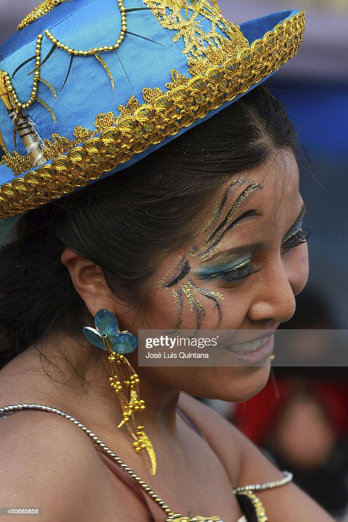 A costumed participant dances 'Caporales' during the religious festival of Jesus del Gran Poder on June 15, 2014 in La Paz, Bolivia. About thirty thousand people attended the event, which is a traditional folk celebration in the country.