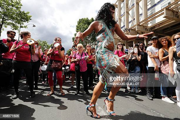 A costumed participant dances during the Gay Pride parade in Paris on July 2 2016 / AFP / FRANCOIS GUILLOT