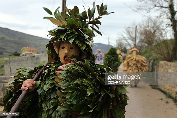 A costumed participant parades during celebrations of 'La Vijanera' carnival in Silio in the northern Spanish province of Cantabria on January 3 2016...