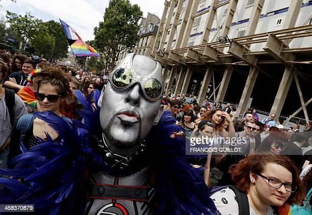 A costumed participant poses for photographs during the 'Gay Pride' parade in Paris on July 2 2016 / AFP / FRANCOIS GUILLOT